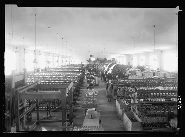 "Jewish factories in Palestine on Plain of Sharon & along the coast to Haifa. Ramath Gan. The ""Meshi"" Silk Company. (Carding) the main work room, int[erior]"