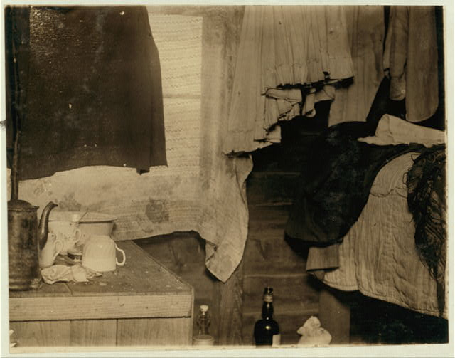 Interior of one of the living rooms in shack used by pickers on Theodore Budd's Bog, Turkeytown, near Pemberton, N.J. Three persons lived in this room. See photo #1114. This is the fourth week of school in Philadelphia and people will stay here two weeks more. E. F. Brown.  Location: Pemberton, New Jersey.