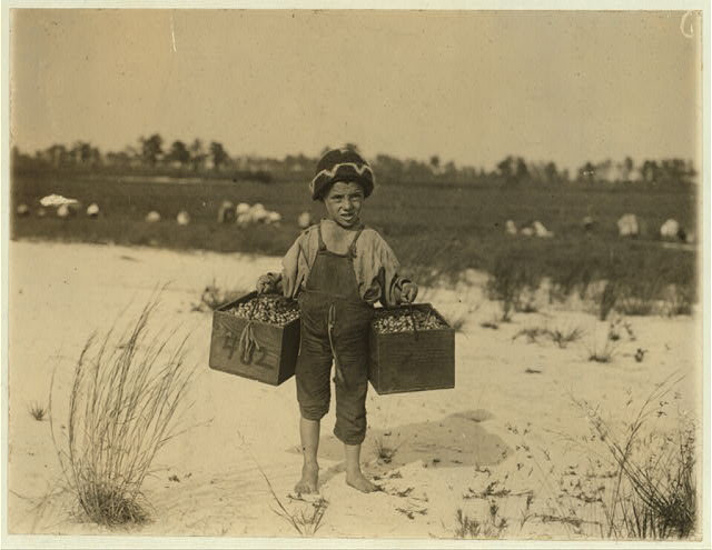 "Salvin Nocito, 5 years old, carries 2 pecks of cranberries for long distance to the ""bushel-man."" Whites Bog, Browns Mills, N.J. Sept. 28, 1910. Witness E. F. Brown.  Location: Browns Mills, New Jersey"