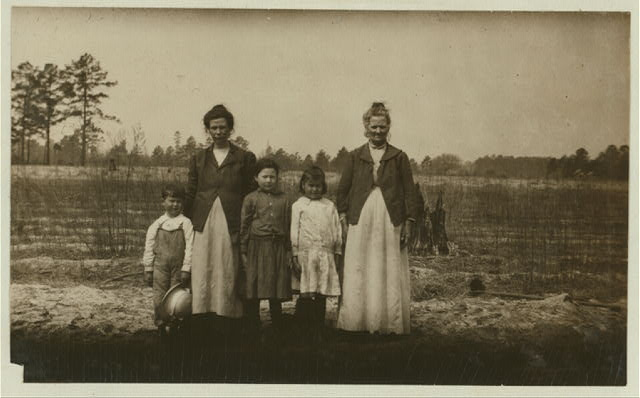 The Britt family happy and content on the farm. See report of Lewis W. Hine on North Carolina, April 1915.  Location: Evergreen, North Carolina.