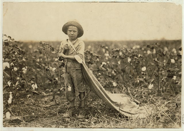 "6-year old Warren Frakes. Mother said he picked 41 pounds yesterday ""An I don't make him pick; he picked some last year."" Has about 20 pounds in his bag. See 4574.  Location: Comanche County, Oklahoma"