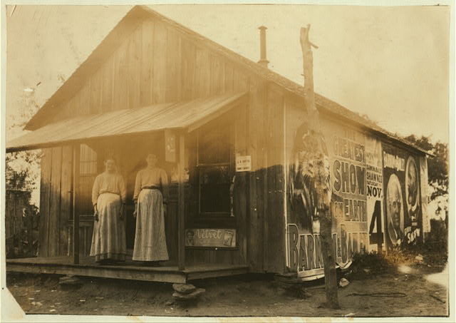 A little country store near New Hope School #41. Mrs. M.E. Geralds, P.O. Route 2, Tecumseh, Okla., is in charge; also a customer. Lewis W. Hine. See W.H. Swift Report.  Location: Potawotamie County, Oklahoma.