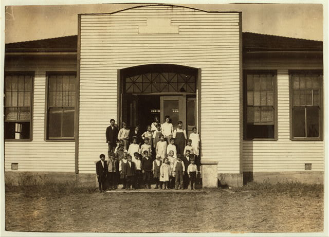 [Acme School #24 (4 miles northwest of Shawnee): Miss Lois Millard, Principal. (P.O. Dale, Okla., Route 1). 26 present, 40 expected after all families return from southern part of the state where they have been picking cotton. Lewis W. Hine. See W. H. Swift Report.]  Location: [Potawotamie County, Oklahoma]