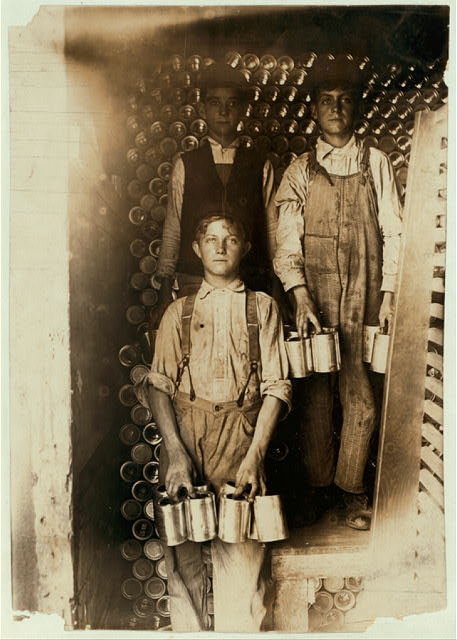 Boys Working in a Cannery, Indianapolis, Unloading freight cars full of new tomato cans.  Aug., 1908. Wit., E. N. Clopper.  Location: Indianapolis, Indiana.