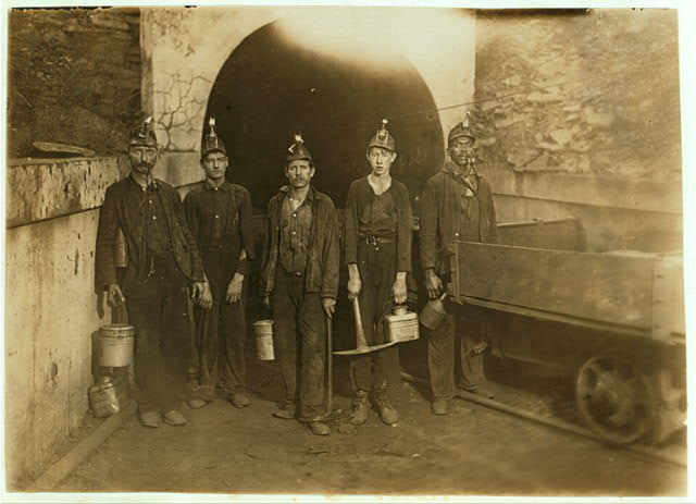 "National Child Labor Committee. No. 92. Main entrance Gary W. Va. Mine. Miners going into mine 7 A.M. Boy beginning career as ""picker."" Will be in mine over 10 hours consecutively. 7 A.M. to 5:30 P.M.  Location: Gary, West Virginia."