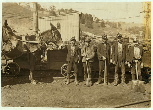 Tipple Boy and Drivers. Maryland Coal Co. Mine, near Sand Lick, Grafton, W. Va. Boy with mule was afraid at first to be in the picture: another boy said he feared we might make him go to school.  Location: Grafton, West Virginia.