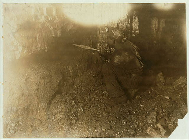 Miner picking coal. Out of narrow seam (5.5 ft.) Makes $2 $9.00 a day (some days). Brown Mine, Brown , W. Va.  Location: Brown, West Virginia.