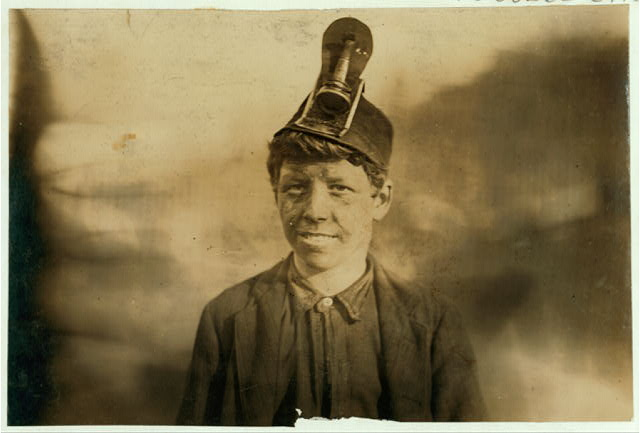 National Child Labor Committee. No. 191. Frank, a Miner Boy, going home. About 14 years old: has worked in the mine helping father pick and load for three years: was in hospital one year, when leg had been crushed by coal car.