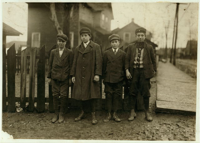 Four Breaker Boys working in #9 Breaker, Hughestown Borough. Boy on left is Tony Ross, 142 Panama Street, other small boy is Mike Rosa [i.e., Ross?], cousin.  Location: Pittston, Pennsylvania.