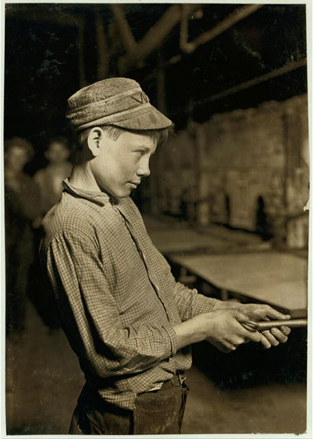 Carrying-in Boy at the Lehr, (15 years old) Glass Works, Grafton, W. Va. Has worked for several years. Works nine hours. Day shift one week, night shift next week. Gets $1.25 per day.  Location: Grafton, West Virginia.