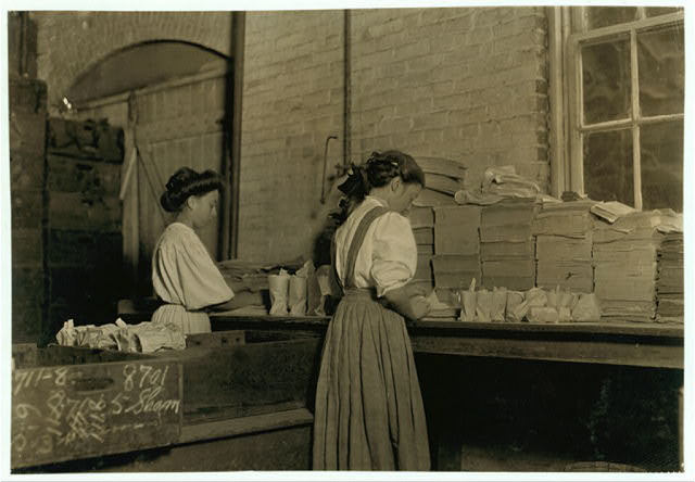 Seneca Glass Works, Morgantown, W. Va. Girls wrapping and packing. Girl in centre said she was 13. this is a co-operative institution run in the interests of the workers as well as employers; do not work at night; yet they use small girls and many small boys. Oct., 1908.  Location: Morgantown, West Virginia.