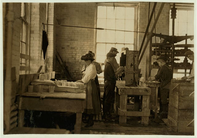 Girls, boys and men, polishing and wrapping, working together: morals in glass factory are proverbially bad. Union Stopper Co., Morgantown, W. Va.  Several very young girls and many small boys working here.  Location: Morgantown, West Virginia.