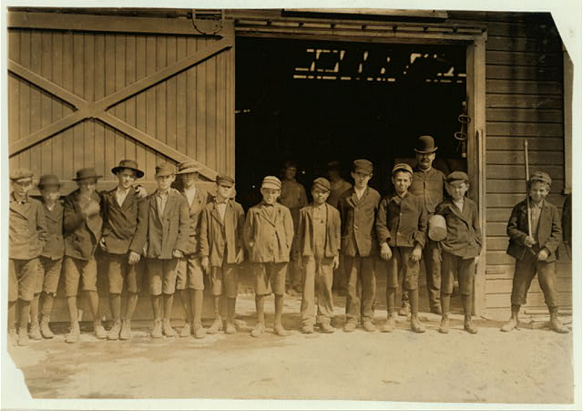 Boys going home from Glass Works, Monongah Glass Works, Fairmont, W. Va.  Location: Fairmont, West Virginia.