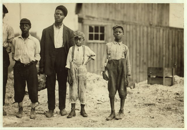 In the Alexandria glass factories, negroes work side by side with the white workers. Also in Richmond. These are some of those working in Alexandria (Va.) Glass Factory.  Location: Alexandria, Virginia.