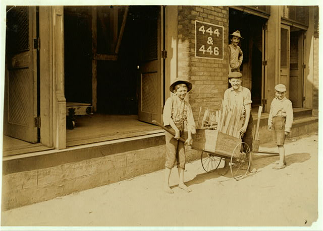 Boys, carrying home Firewood from Factory. Cincinnati. Aug. 1908.  Location: Cincinnati, Ohio.