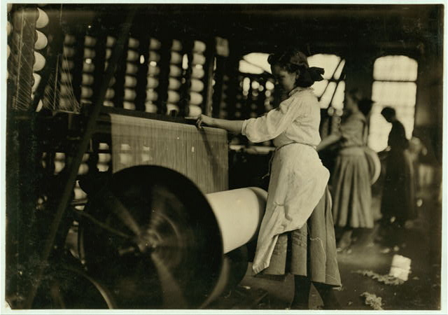 Lincoln Cotton Mills, Evansville, Ind. Girls at weaving machine; warpers.  Location: Evansville, Indiana.