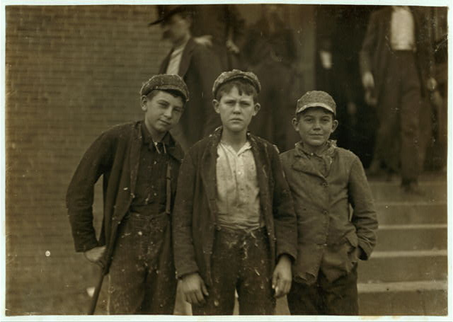 Going home from Loray Mill. Smallest boy on the right hand end, John Moore. 13 years old. Been in mill 6 years as sweeper, doffer and spinner.  Location: Gastonia, North Carolina.