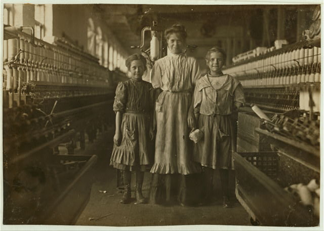 Rhodes Mfg. Co., Lincolnton, N.C. National Child Labor Committee. No. 282. Girl on left said she was 10 years old and been in mill a long time more than a year. Spinner girl on right said she was 12 years.  Location: Lincolnton, North Carolina.