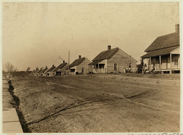 A row of houses of the cotton mill people. Lydia Mills, Clinton, S.C. Witness, Sara R. Hine. Dec. 2, 1908. L.W.H.  Location: Clinton, South Carolina.