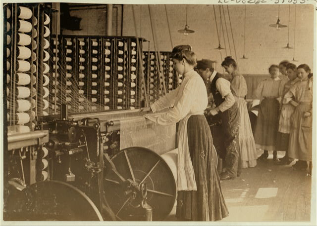 Mollahan Mill, Newberry, S.C. Type of young woman at spinning machine in cotton mills.  Location: Newberry, South Carolina.