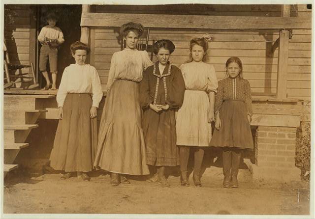 Dillon Mills, Dillon, S.C. Lizzie Davis, (smallest). Been in mill 2 years. Next--Nettie Arnet - Been in mill 8 years. Next--Monnie McCraney, been in mill 3 years. Next--Vater Arnet, been in mill 8 years. Next--Mattie Connor, spinners and Winders. Saturday, Dec. 5, 08.  Location: Dillon, South Carolina