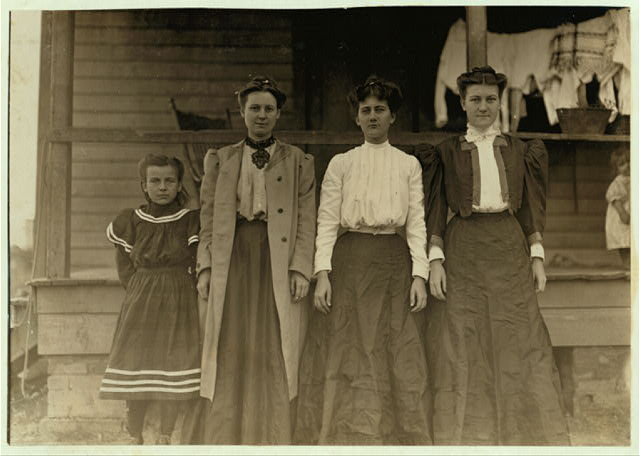 "Some operatives--Dillon Mill, Dillon, S.C. Smallest girl said she ""helps.""  Location: Dillon, South Carolina."