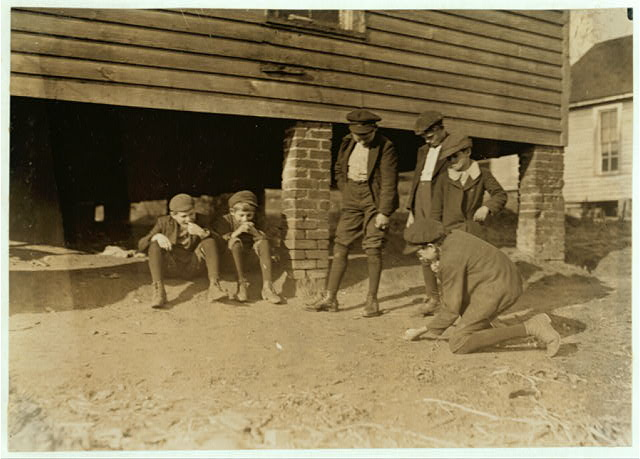 Salisbury, (N.C.) Cotton Mill. A game of marbles. All these boys work in the mill.  Location: Salisbury, North Carolina