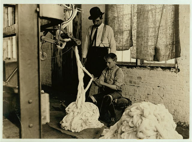Boy at warping machine, Catawba Cotton Mill, Newton, N.C.  Location: Newton, North Carolina.