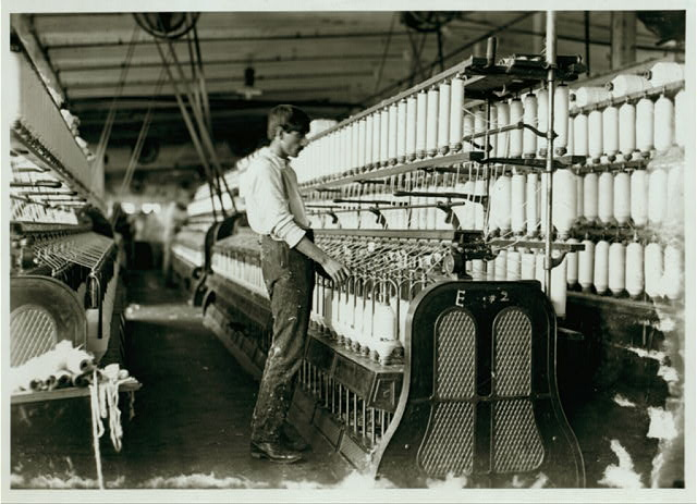 It seems a pity that some of the spinning frames are so large that the children cannot operate them. Catawba Cotton Mills.  Location: Newton, North Carolina.