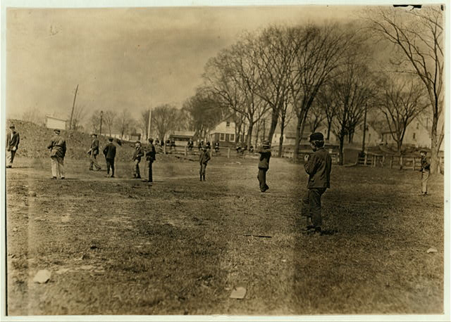 Noon hour ball-game at Quidwick Co. Hill, Anthony, R. I. All of them work in the mill. Note the boy nearest.  Location: Anthony, Rhode Island.
