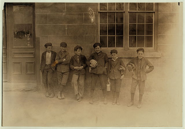 Noon hour, April 17, 1909. All these boys (and many others) work in the Natick (R.I.) Mills. Some of the smaller ones said they worked there two years.  Location: Natick, Rhode Island.