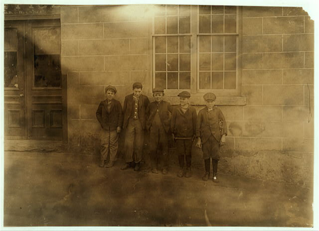A few of the small boys working in the Natick (R. I.) Mills. Some of the smallest ones said they worked there 2 years.  Location: Natick, Rhode Island.