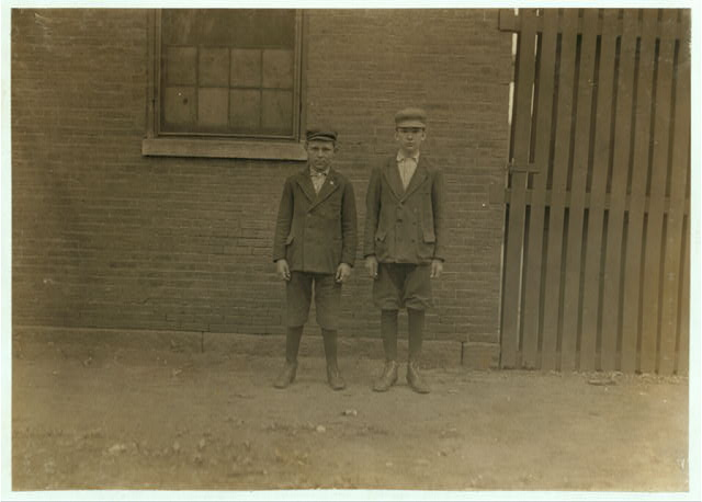 Boys working in Great Falls Mfg. Co., Somersworth, N.H. Right hand boy John Velvile. Been in mill one year. Left hand boy Arthur Roy, 5 Union St., 8 Months in mill.  Location: Somersworth, New Hampshire.