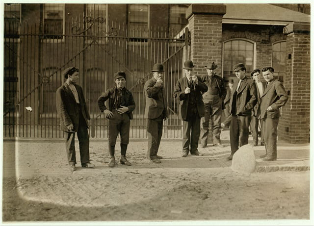6:00 A.M., May 15, 1909. Group going into Mill No. 1 Cocheco Mfg. Co., Dover, N.H.  Location: Dover, New Hampshire.