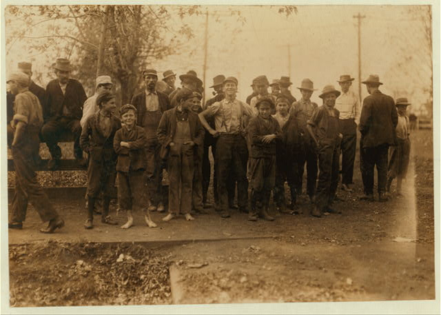 Group of boys, Merrimac Mills, noon-hour. They would not tell me the truth about their ages.  Location: Huntsville, Alabama.