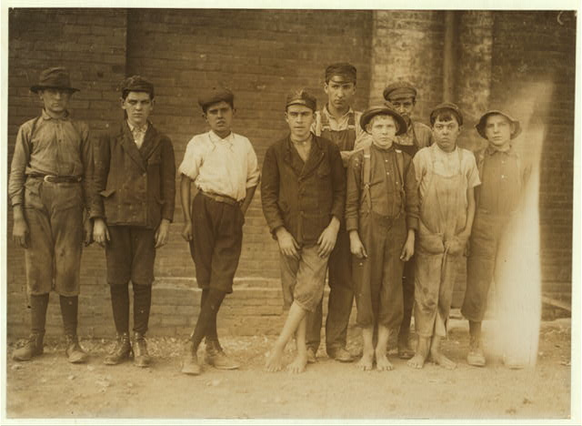 Group of doffers working in Pell City Cotton Mill arranged by the Overseer. Superintendent of mill is also Mayor of Pell City.  Location: Pell City, Alabama.