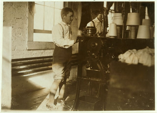 Boy working in Talladega Hosiery Mills.  Location: Talladega, Alabama.