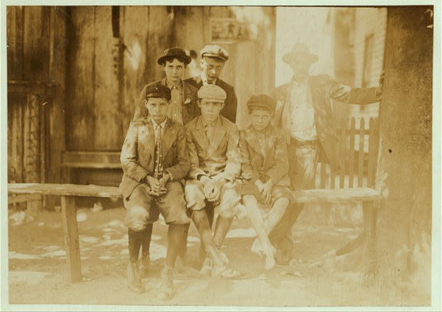 A Sunday hand-out of doffers and other mill fellows. Reputed a bad lot. Smallest boy is Arthur, said he was 13 (doubtful) & been in mill 4 years. Get $3.50 a week now.  Location: [Columbus?, Mississippi?].