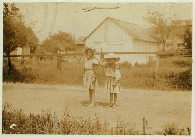 Inez Johnson (nine years old) and Lily, her cousin (seven years old). Both were helping Mrs. Johnson, a spooler in Tupelo (Miss.) Cotton Mills. Inez says she works regularly.  Location: Tupelo, Mississippi.