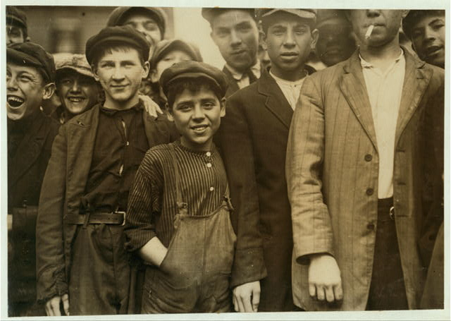 [Group of workers. The smallest boy in the middle of group is Secondino Libro, 34 Walnut Street. Apparently 10 or 11. Works in No. 4 Spinning room.]  Location: Lawrence, Massachusetts.