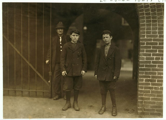 Alber Therien at right end of picture, 30 Salem Street, appears 13 years old, has been 4 weeks in spinning room No. 9, on the fourth floor of the Lawrence mills. Joseph Guerard, left hand end of picture, 21 Perkins Street, appears 12 years old, has worked 12 months. Neither speaks nor understands English.  Location: Lowell, Massachusetts.
