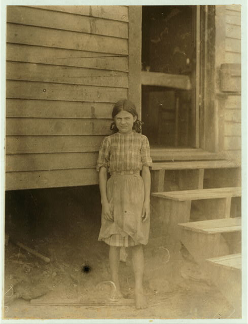 "Nerva Wright, 119 William St., runs 4 sides in Saxon Mill, Spartenberg [sic], S.C. Been spinning one year. 3 children are in the mill. ""My eyes hurt me when I'm out doors. It's so dark in the spinnin room.""  Location: Spartanburg, South Carolina."
