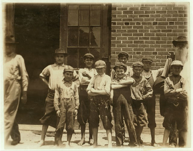 Some of the youngsters working in Belton Mfg. Co., Belton, S.C. Two of the youngest and J. Henderson, Kelly Street. Percy Morrison, Eugene Simper.  Location: Belton, South Carolina.