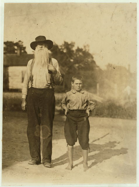 "Extremes of age in the Belton Mfg. Co., S.C. The boy is Fred Willingham. Been working six months in the Bolton Mfg. Mill. Gets 50 cents. Sweeps. His next older brother has been doffing a year or two. Fred and his older sister had some confusion about the age, first making him out ""goin on 12"" and then they raised it. Sister said record was not in the bible. Father and two boys in the mill.  Location: Belton, South Carolina."