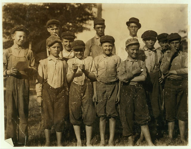 Group of boys in the Belton Cotton Mill. The smallest is Milton Honicutt, 11 years old according to the bible and James Taylor. His parents wouldn't show me the family record.  Location: Belton, South Carolina.