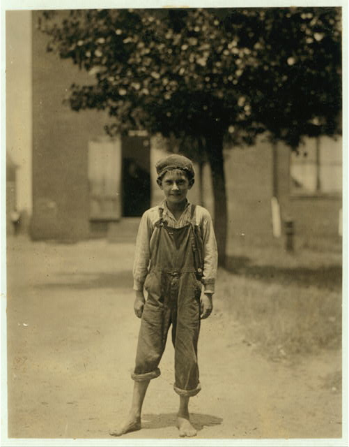 National Child Labor Committee. #3026 Johnnie Beam, one of the young workers in the Pelzer Mfg. Co., S.C. Been working here over a year. Appears to be under 12 years.  Location: [Pelzer], South Carolina.