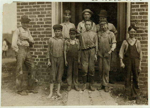 Workers in the Nokomis Cotton Mill, Lexington, N.C. The smallest boy said he was 11 years old and makes 50 cents a day. Been doffing there for some months. The Band Boy who seems much younger would not be photgraphed. Also several other young workers.  Location: Lexington, North Carolina.