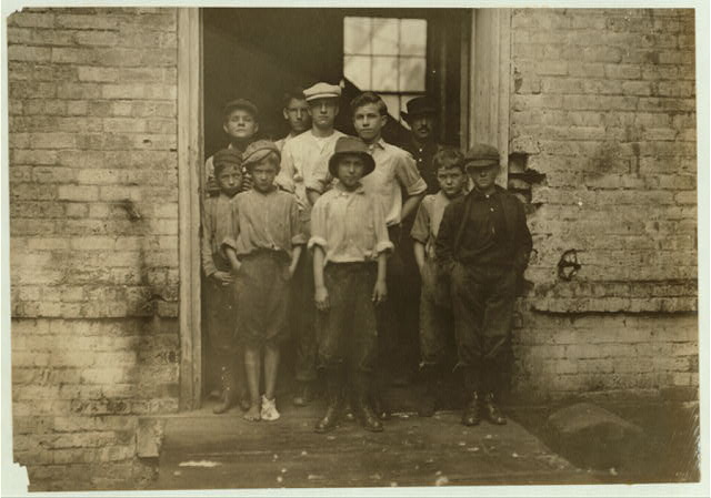 Noon. Group of doffers and sweepers in Cabarrus Mill, Concord, N.C. These are not all that were working here.  Location: Concord, North Carolina.