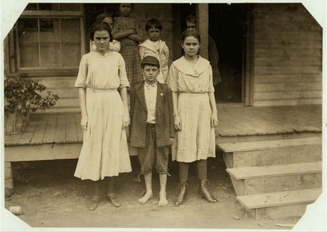 "The three on the ground work in the Cannon Mills, Concord, N.C. The boy ""Otie Honeycott"" (his mother could not spell his name) said he had been doffing two years in the Cannon Mill.  Location: Concord, North Carolina."
