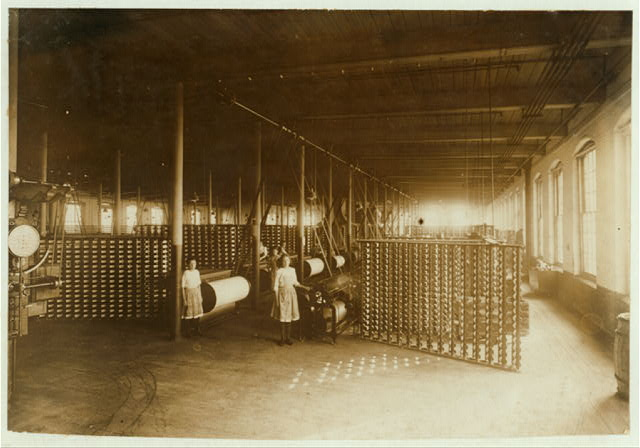 (For Child Welfare Exhibit 1912-13.) View of warping room, Lonsdale, R.I. Mills.  Location: Lonsdale, Rhode Island.